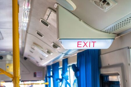 Emergency exit light sign on bus direction sign for safety when have any situation.  EXIT security sign for save passengers. Imagens