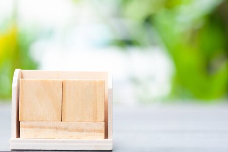 Close up empty cube boxes on wooden table and blur background.