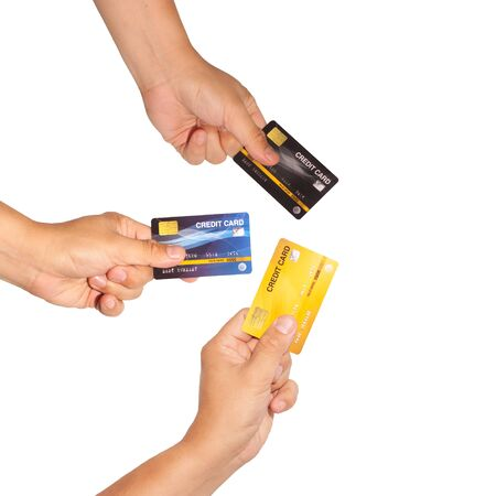 Unidentified man hand holding many credit cards isolated for do some financial transaction.  Business financial technology for moneyless with credit card. 版權商用圖片