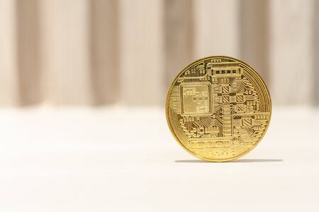 Gold bitcoin cryptocurrency blockchain financial on table, new money monetary value. 写真素材 - 130040927