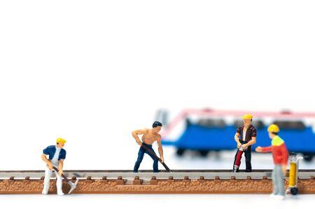 Selective focus miniature people team repair train tracks, The foreman ordered the railway repairman. 写真素材