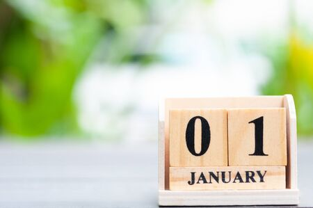 Calendar cube wooden block with blur background, first day of year. 写真素材 - 130041155