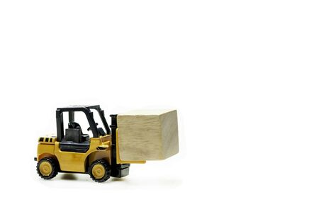 Forklift carry single cube wooden block moving left to right with copy space,