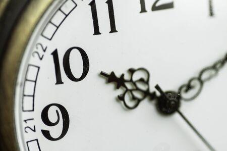 Close up vintage pocket watch 10 hour 10 minutes, classic clock style retro concept. Imagens