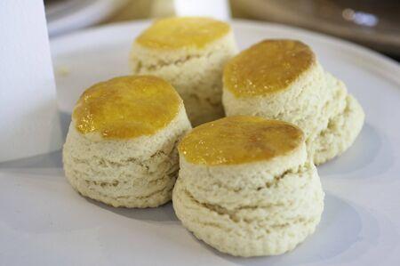 Butter scone in white plate for tea break, favorite bakery.