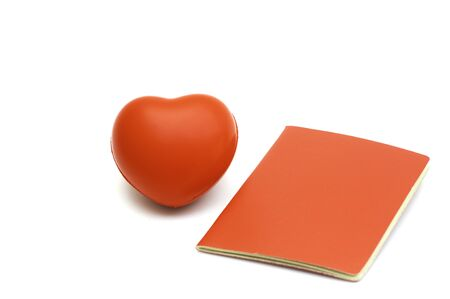 Single red heart with red record note book on white background,