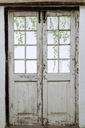 Double white vintage door, class retro house interior. White door with grunge stain.