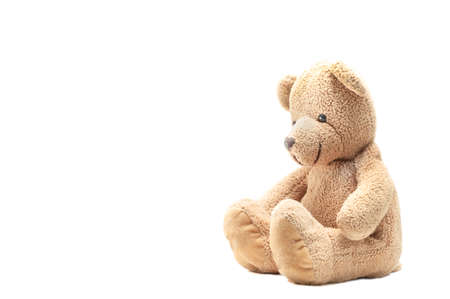Bear doll teddy bear sitting and looking to camera on white, toy for children. Imagens