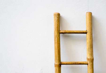 crack climb: bamboo ladder on the white wall