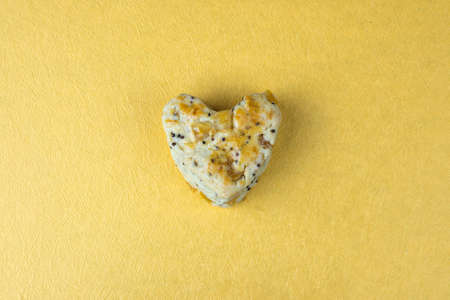 scone: Cookie scone in heart shape on golden background.