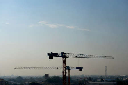 industrail: Big crane on foggy sky background present pollution in the city.