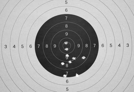 accurately: Bullet hole on black and white paper target Stock Photo