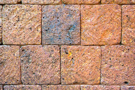 porous brick: Texture of brown stone wall.