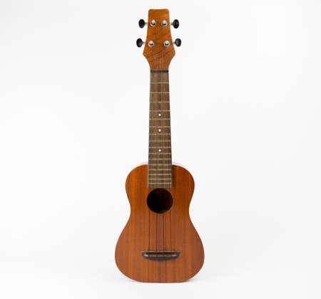 mahogany: Full shot of mahogany ukulele on white background. Stock Photo