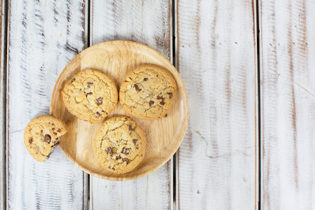 chocolate chip cookie: Overhead view of chocolate chip cookies on wooden tray
