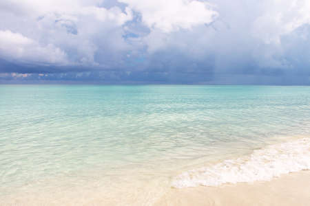 Seascape - bright azure Caribbean Sea and cumulus clouds. Picture taken in Cuba. Stock Photo