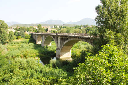 Spain, Besalu - June 28, 2012 the bridge leading to the medieval city of Catalonia - national, historical and cultural monument of the country - an interesting open-air museum.