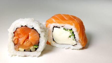 japanese sushi food. Rolls with salmon. Top view of assorted sushi. Stock Photo