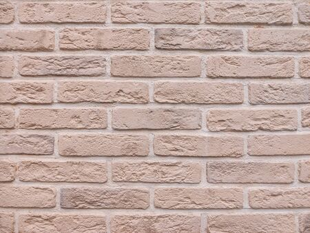 background of the wall is a brown brick surface. Abstract wall background.