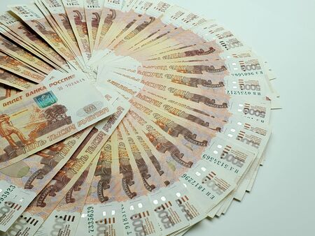 wad of Russian money on an isolated dark background. a large amount of money.