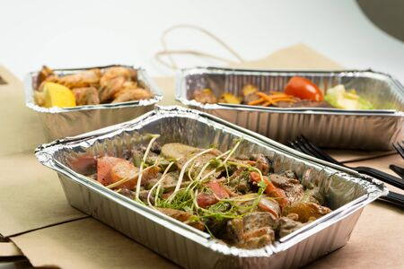 Take-away food, bring your lunch in business boxes, or foil containers.