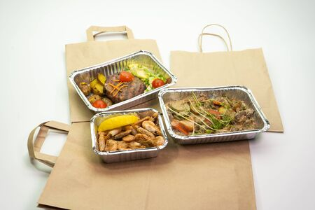 Healthy restaurant food with home delivery. Food delivery during the period of self-isolation. Stock Photo