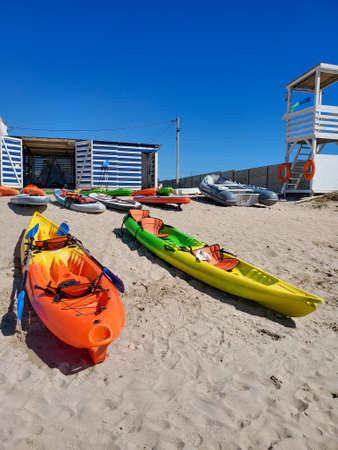Active recreation, sports, kayak. Boat for rafting on water. Two kayaks stand on a sandy beach on the coast.