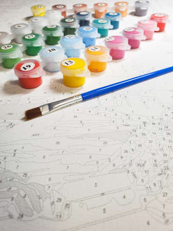 Picture by numbers. drawing by numbers as a creative hobby. Standard-Bild