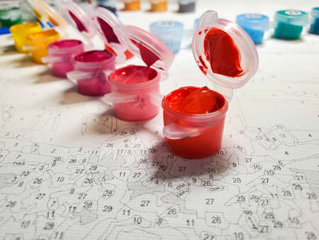 lots of bright acrylic paints on canvas. drawing by numbers. lots of bright acrylic paints on canvas. drawing by numbers.
