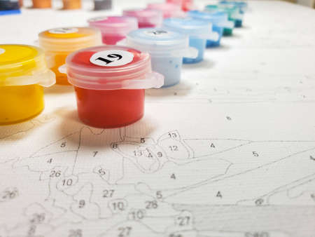 painting by numbers. Drawing kit, includes canvas, brushes and lots of colorful acrylic paints. Selective focus.