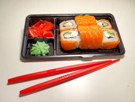 online food ordering and home delivery Service during the coronavirus quarantine. Delivery of sushi and rolls.