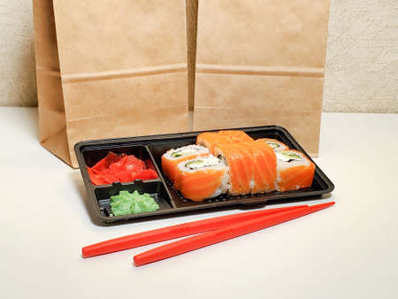 takeaway Lunch, delivery of sushi menu in lunch boxes. The concept of delivery.