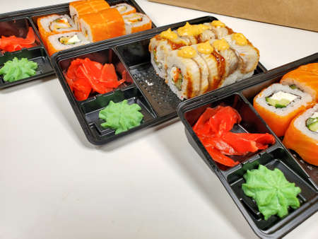 Sushi rolls are Packed in plastic packaging close-up on an isolated background.