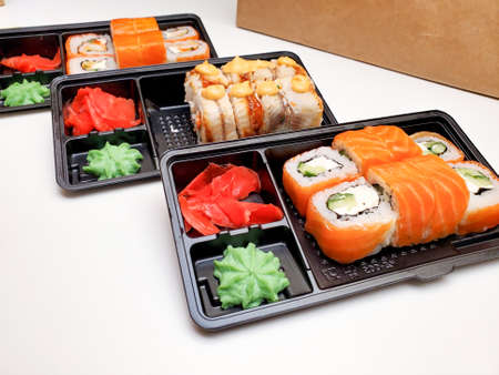 Assorted sushi rolls on an isolated white background. Delivery of Japanese cuisine. Standard-Bild