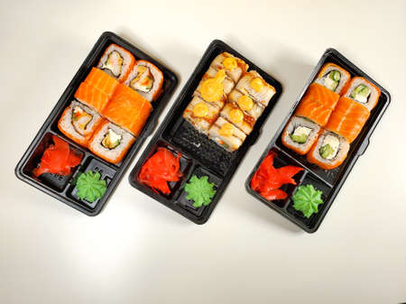 food Supplies. Sushi and rolls with salmon and shrimp. The concept of food delivery on self-isolation.