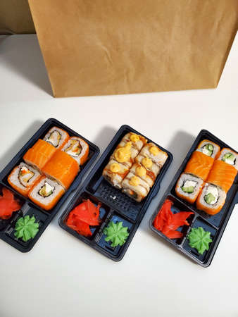 Japanese sushi roll for dinner on an isolated white background. The concept of the delivery of Japanese dishes.