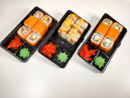 Assorted sushi rolls on an isolated white background. Delivery of Japanese cuisine