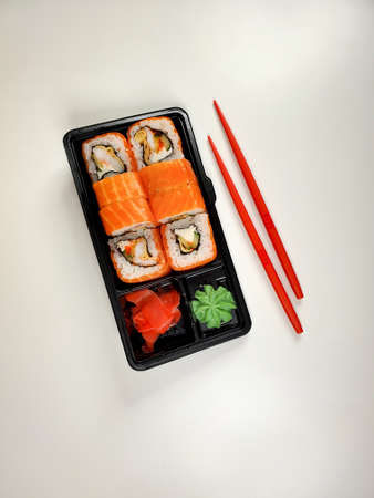 close-up of Japanese sushi rolls for dinner or lunch on an isolated white background. The concept of delivery of Japanese cuisine