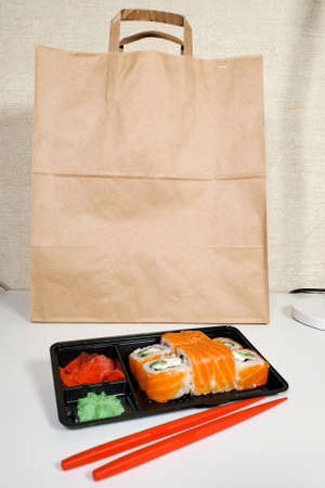Japanese sushi roll for dinner on an isolated white background. The concept of the delivery of Japanese dishes