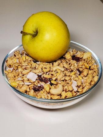 apple, oatmeal, muesli breakfast in a bowl