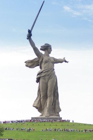 VOLGOGRAD, RUSSIA - MAY 9, 2018: People climb the stairs on the Mamayev Kurgan to the statue of the Motherland Calls. Immortal regiment at Mamaev Kurgan. Editorial