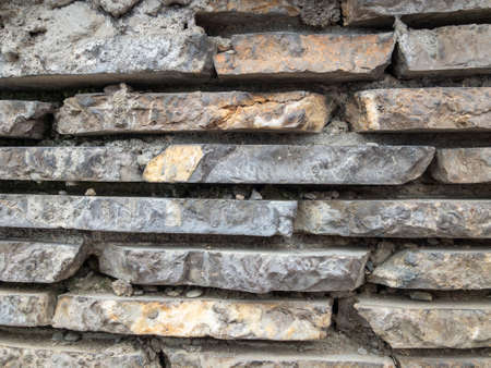 The surface of a stone wall. Masonry walls of old stone blocks. Background texture of a stone wall.