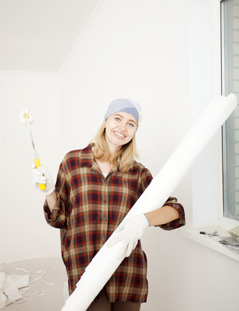 home repairs: the girl is the one doing home repairs