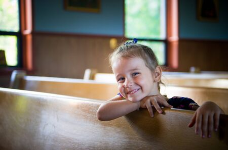 Portrait of the smiling girl in the orthodox church photo