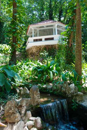 Pergola and waterfall in Botanical Garden in Rio de Janeiro photo