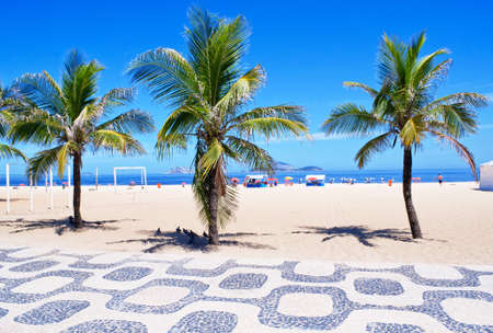 View of Ipanema beach with palms and mosaic of sidewalk