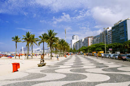 View of Copacabana beach with palms and mosaic of sidewalk photo