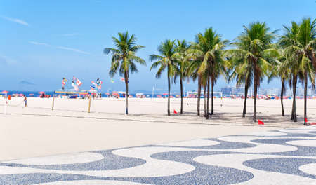 brasil: View of Copacabana beach with palms and mosaic of sidewalk