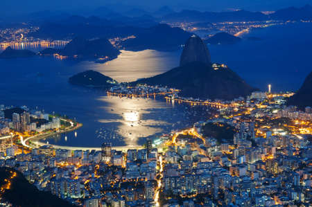 brazil: Night view of mountain Sugar Loaf and Botafogo in Rio de Janeiro Stock Photo