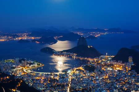 Night view of mountain Sugar Loaf and Botafogo in Rio de Janeiro Stock Photo